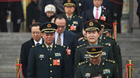 Military delegates leave after the opening session of the CPPCC at the Great Hall of the People in Beijing on March 3, 2018.