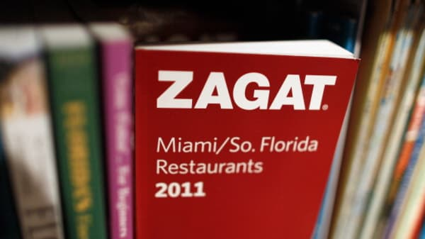 A 2011 Zagat guide sits on a bookshelf.