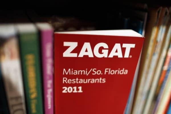 A 2011 Zagat guide sits on a bookshelf.