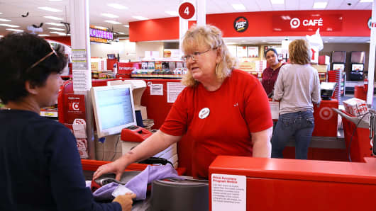 A Target worker helps a customer at a Target store in San Rafael, California.