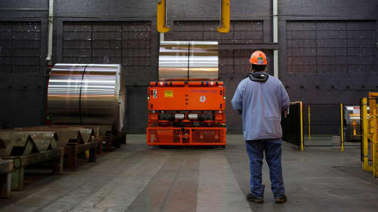 A worker controls a crane to move an aluminum coil at the Arconic Inc. manufacturing facility in Alcoa, Tennessee.