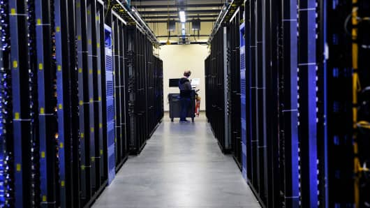 An employee fixes part of a web server inside the Facebook Prineville Data Center in Prineville, Oregon.