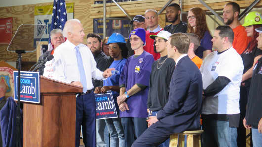 Former Vice President Joe Biden campaigns for Democratic congressional candidate Conor Lamb, seated, outside of Pittsburgh, PA on March 6, 2018.