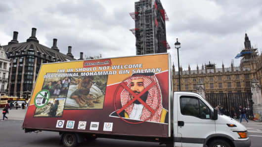 A lorry with a banner protesting against the visit on Wednesday by Mohammed bin Salman, Crown Prince of the Kingdom of Saudi Arabia drives around Westminster.