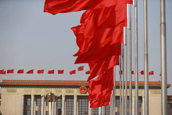 Flags fly in front of the Great Hall of the People in Beijing, China, on March 5, 2018.