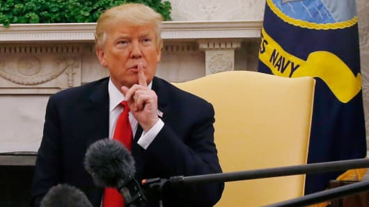 President Donald Trump gestures while meeting with Sweden's Prime Minister Stefan Lofven (not pictured) in the Oval Office at the White House in Washington, U.S., March 6, 2018.