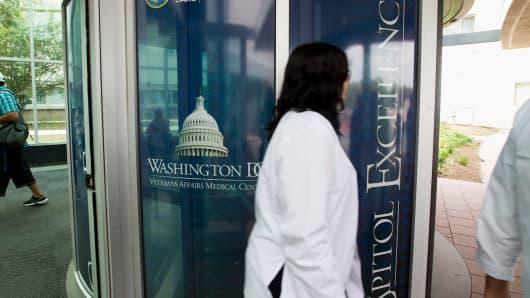 People walks part the entrance of the Washington VA Medical Center in Washington, DC.