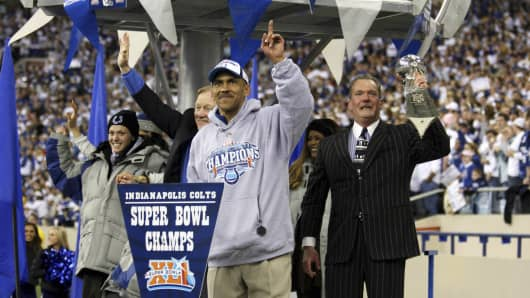 Colts owner and vice chairman Carlie Irsay-Gordon (left) and her father, Indianapolis Colts owner and CEO Jim Irsay (right), holding the Vince Lombardi Trophy after the Colts victory over the Chicago Bears in Super Bowl XLI. Former Colts head coach Tony Dungy in foreground.