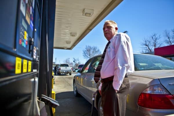 A customer fuels his car at a QuikTrip (QT) gas station in Tulsa, Oklahoma