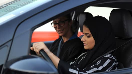 A Saudi woman (front) receives a driving lesson from an Italian instructor in Jeddah on March 7, 2018.