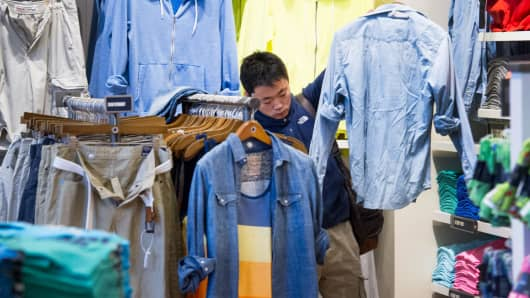 A customer shops for shirts at an American Eagle Outfitters store in San Francisco.