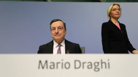 Mario Draghi, president of the European Central Bank (ECB), left, and Christine Graeff, director general for communications at the European Central Bank (ECB), arrive for a news conference following the bank's interest rate decision at the ECB headquarters in Frankfurt, Germany, on March 8, 2018.