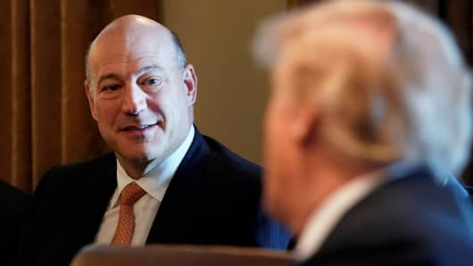 President Donald Trump praises his outgoing economic adviser Gary Cohn (L) during a cabinet meeting at the White House in Washington, March 8, 2018.