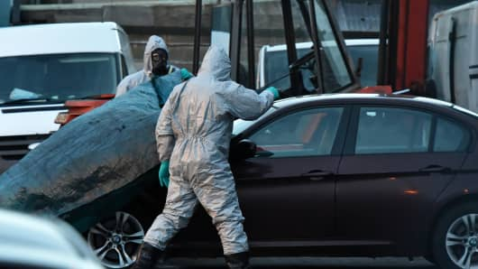 Forensic police officers wearing hazmat suits examine a vehicle believed to belong to Sergei Skripal on March 8, 2018, in Salisbury, England.