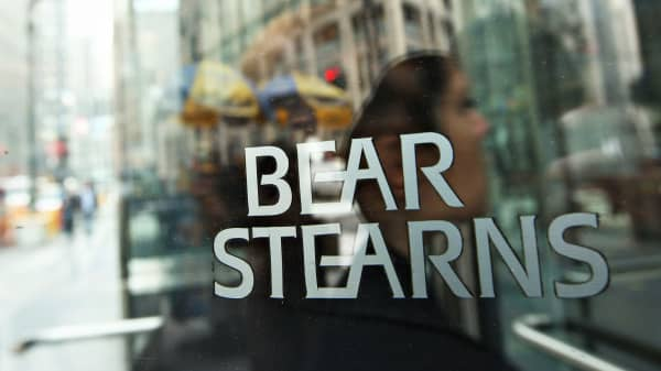 A woman enters Bear Stearns headquarters in New York, March 14, 2008.