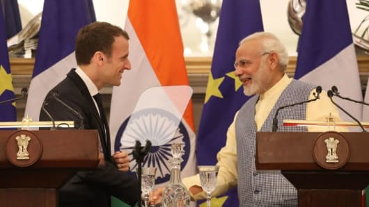 Indian Prime Minister Narendra Modi (R) and French President Emmanuel Macron (L) shake hands as they make a joint press statement in New Delhi on March 10, 2018.