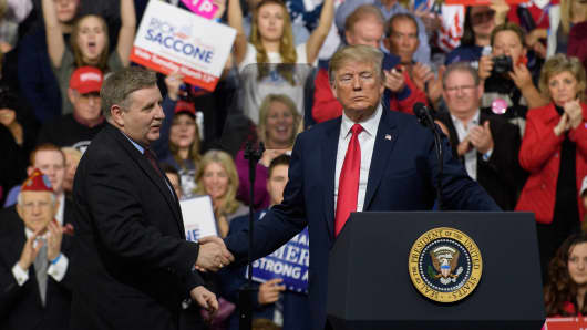 President Donald J. Trump with Rick Saccone speaks to supporters at the Atlantic Aviation Hanger on March 10, 2018 in Moon Township, Pennsylvania.