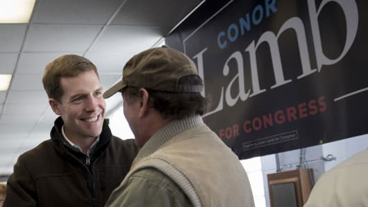 Conor Lamb, Democratic candidate for the U.S. House of Representatives, left, greets an attendee after speaking during a campaign rally with members of the United Mine Workers of America (UMWA) at the Greene County Fairgrounds in Waynesburg, Pennsylvania, U.S., on Sunday, March 11, 2018.