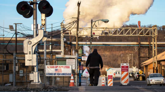 A worker heads toward the U.S. Steel Clairton Works, March 11, 2018 in Clairton, Pennsylvania.