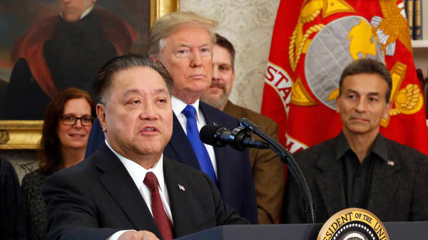 Broadcom CEO Hock Tan announces the repatriation of his company headquarters to the United States from Singapore as U.S. President Donald Trump looks on during a ceremony in the Oval Office of the White House on November 2, 2017 in Washington, DC.