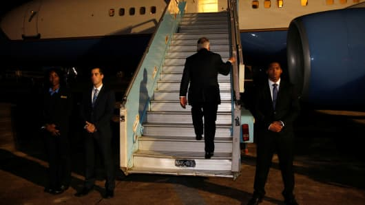 Secretary of State Rex Tillerson boards his plane to depart at the end of a five-country swing through Africa from Abuja, Nigeria, March 12, 2018.