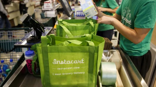 InstaCart employees fulfill orders for delivery