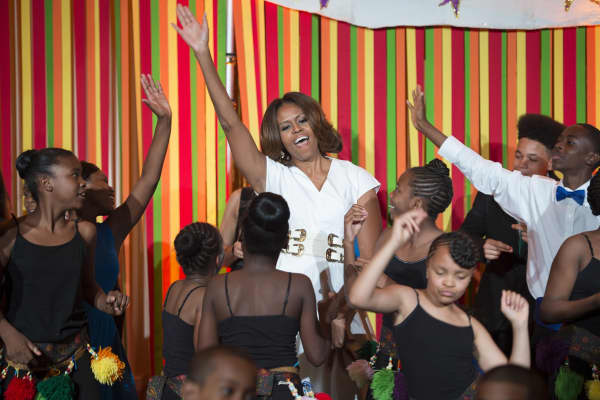 Michelle Obama dances with students during the first-ever White House Talent Show at the White House in Washington, DC in 2014.