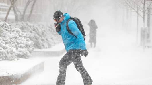 A pedestrian braces himself against high winds and blowing snow while crossing Stuart St. as Winter Storm Skylar bears down on March 13, 2018 in Boston, Massachusetts.