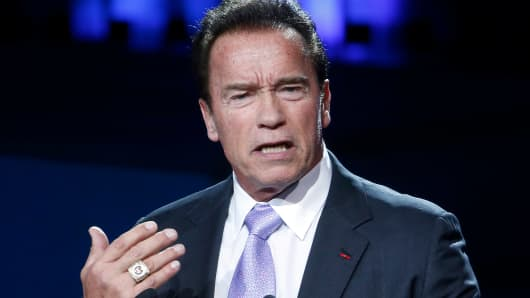 R20 Founder and former California state governor Arnold Schwarzenegger delivers a speech during the One Planet Summit at the Seine Musicale on December 12, 2017 in Boulogne-Billancourt, France.