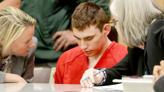 Nikolas Cruz, facing 17 charges of premeditated murder in the mass shooting at Marjory Stoneman Douglas High School in Parkland, appears in court for a status hearing in Fort Lauderdale, Florida, February 19, 2018.