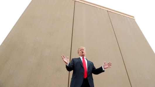 president donald trump speaks while participating in a tour of border wall prototypes