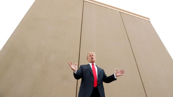 President Donald Trump speaks while participating in a tour of border wall prototypes.