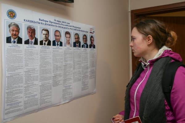 A Russian woman looks at the list of the presidential candidates ahead of casting her vote for the 2018 Russian Presidential Elections at the Honorary Consulate of the Russian Federation in Izmir, Turkey on March 14, 2018.