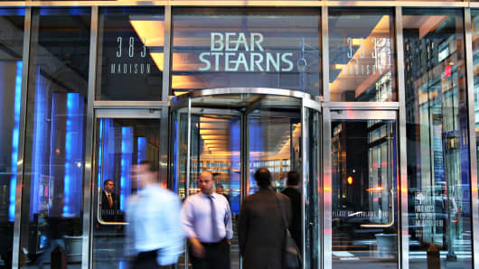 People enter and exit the Bear Stearns headquarters in New York, on Monday, March 17, 2008.