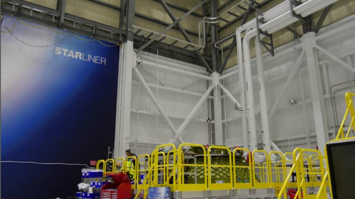 The Starliner facility's underlying Space Shuttle-era infrastructure is visible under the Boeing remodeling.
