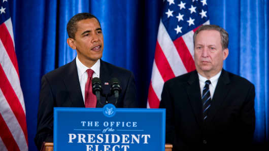 Lawrence (Larry) Summers, Director of the National Economic Council, listens as President Elect Barack Obama announces his new economic team at a news conference in Chicago.