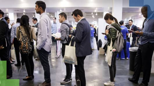 Job seekers wait in line to speak with representative during the TechFair LA career fair in Los Angeles.