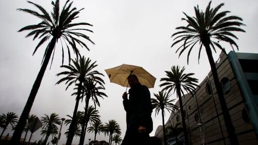 A pedestrian heads to work in Long Beach, California.