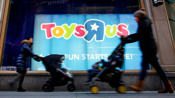 People pass by the Toys R Us store at Times Square in New York, March 9, 2018.