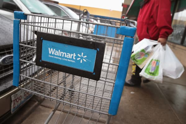 Shopping carts sit outside of a Walmart store in Chicago.