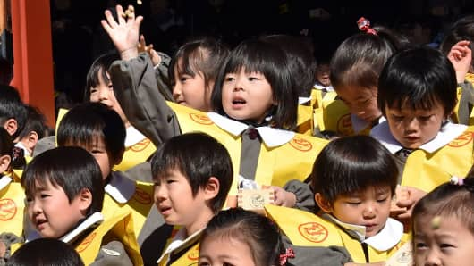 Kindergarten children take part in a traditional ceremony at the Setsubun Festival in Tokyo, Japan.