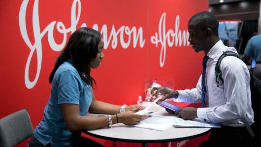 A job seeker talks to a Johnson & Johnson job recruiter at a career fair in Washington, D.C.