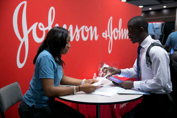 A job seeker talks to a Johnson & Johnson job recruiter at a career fair in Washington, D.C.