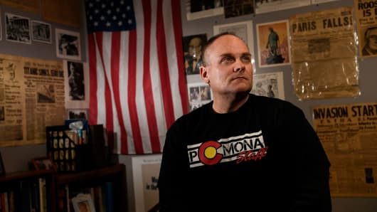 Pomona High School social studies teacher Dale Munholland poses for a portrait before teaching an American history class at Pomona High School on Friday, February 23, 2018. Munholland, who has 20-plus years of teaching experience, said that teachers are there to take care of the kids, but shouldn't be expected to engage an active shooter.