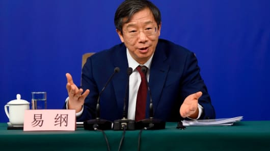 Yi Gang answers a question at a press conference during the First Session of the 13th National People's Congress in Beijing.