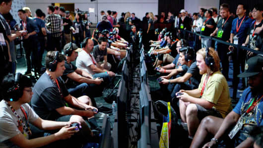Attendees play the 'LawBreakers' video game by Nexon Co. during the E3 Electronic Entertainment Expo in Los Angeles, June 13, 2017.