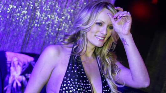 Adult-film actress Stephanie Clifford, also known as Stormy Daniels, poses for pictures at the end of her striptease show in Gossip Gentleman club in Long Island, New York, February 23, 2018.