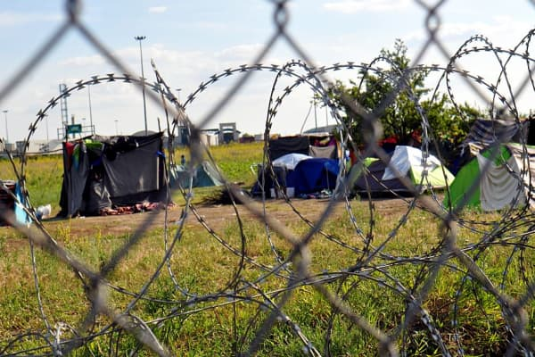 Refugees try to live under hard conditions in a tent camp as Hungary closes its Serbia and Croatia borders with razor wire fence, near Csongrad, Hungary on June 9, 2016.