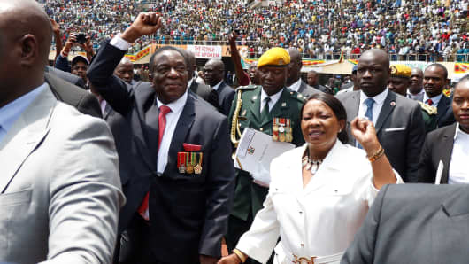 New Zimbabwean President Emmerson Mnangagwa greets the crowd at the National Sports Stadium during his oath-taking ceremony in Harare, Zimbabwe, on November 24, 2017.
