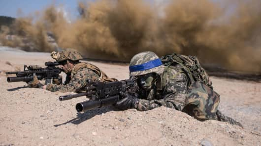South Korean and US soldiers take a position during an annual joint military landing exercise in Pohang, on South Korea's southeast coast.